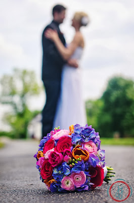 purple hydrangea, pink rose, pink ranunculus, freesia, orange tulips