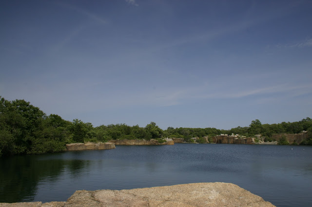 A view from a slab of granite at the water filled quarry at Halibut Point State Park.