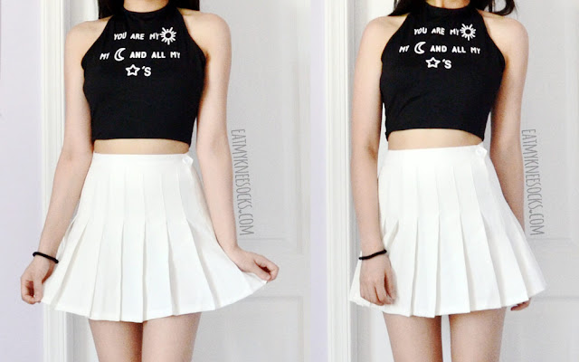 An ulzzang-inspired monochromatic outfit featuring Dresslink's halter tie-back crop top and a white pleated American Apparel tennis skirt.
