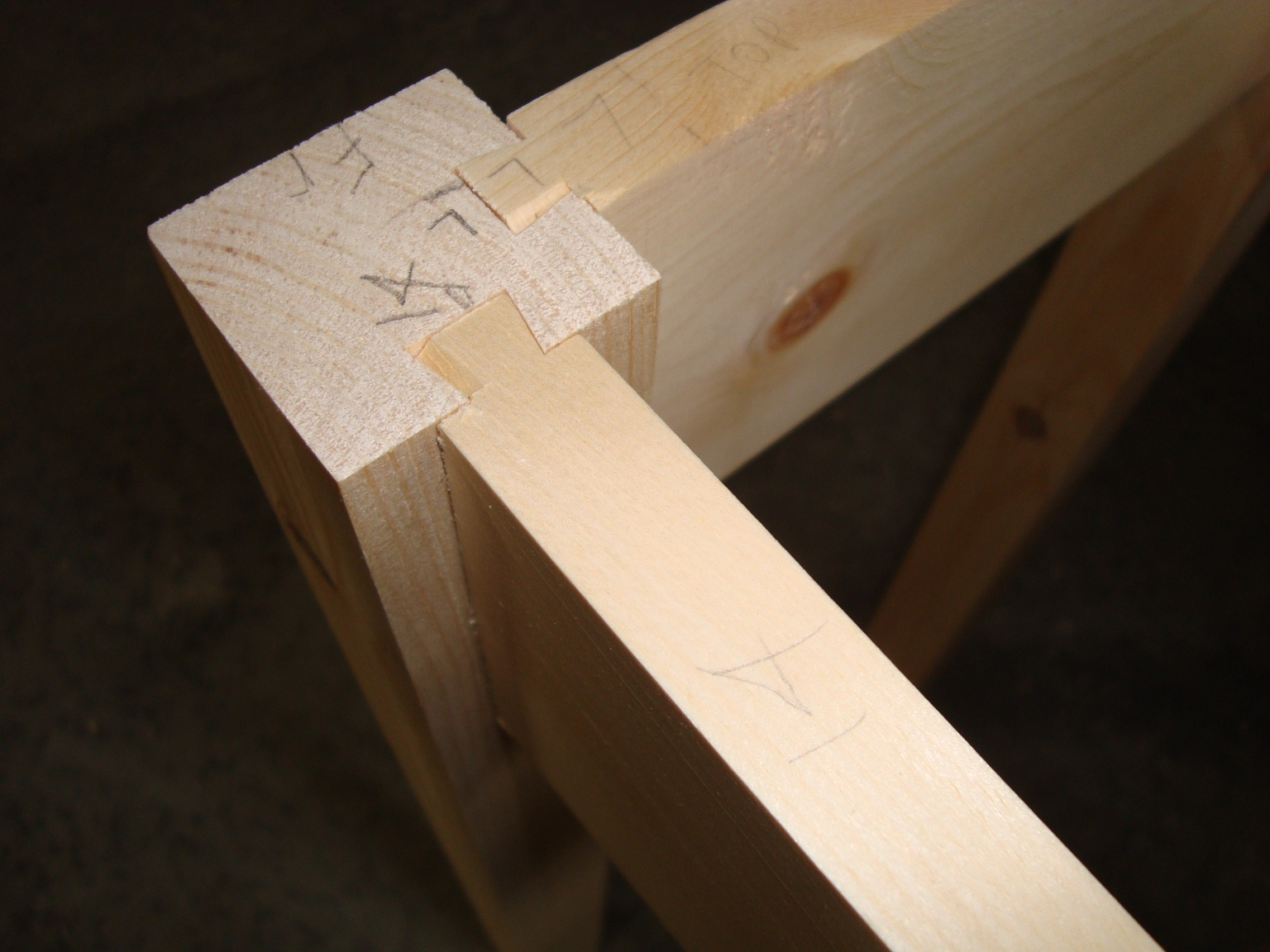 ... sides and back are made from gluing side-to-side strips of pallet wood