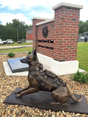 Military dog bronze statue by Lena Toritch at Camp Lejeune