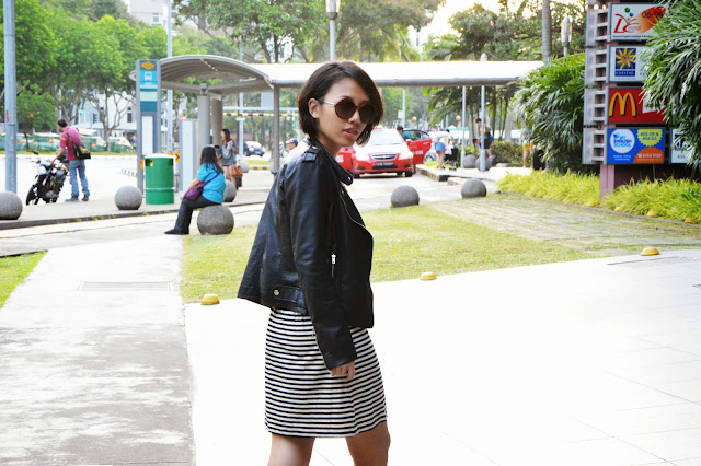 black leather jacket H&M, round sunglasses