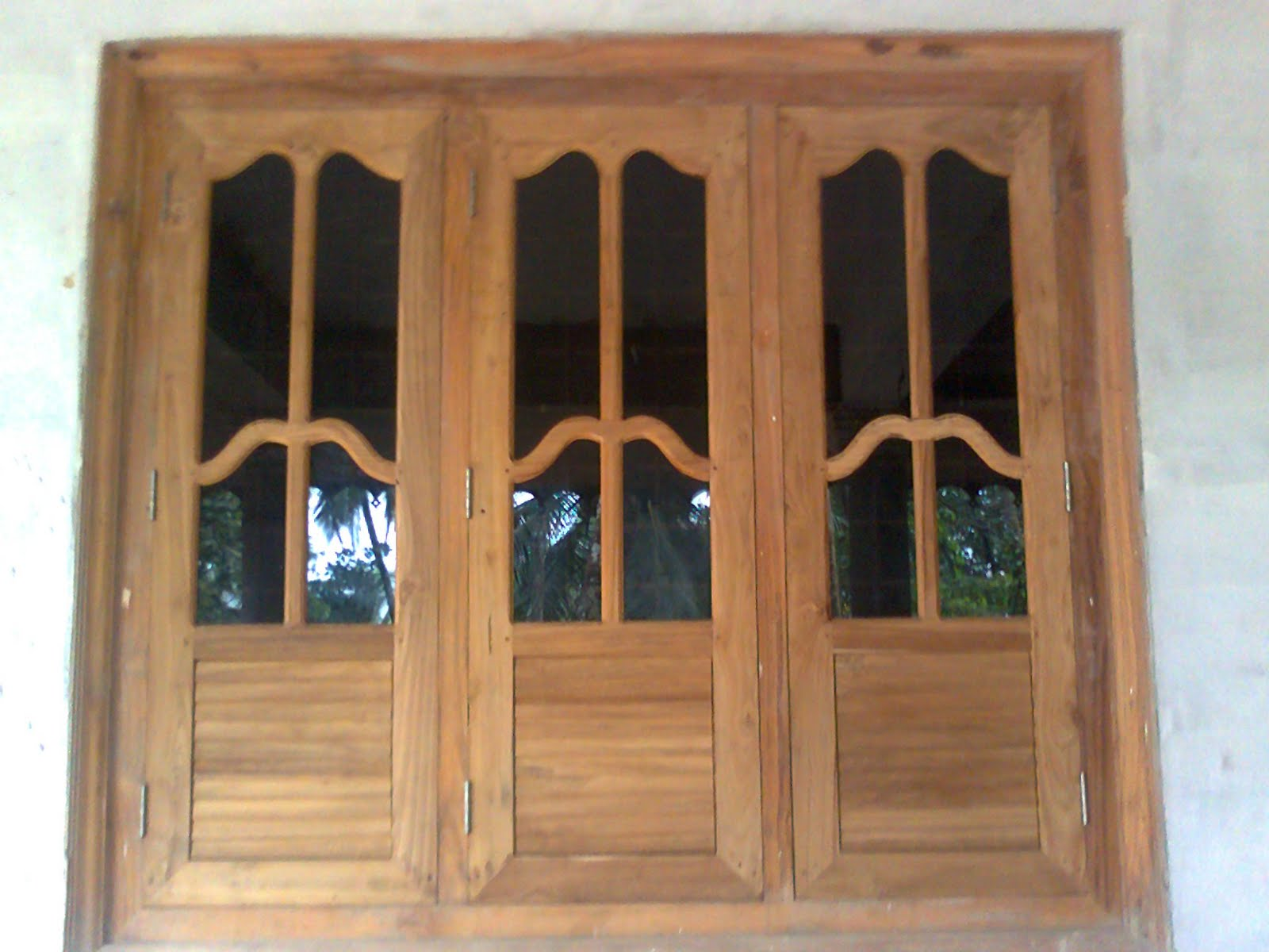 Bavas wood works wooden window doors simple designs for Window net design