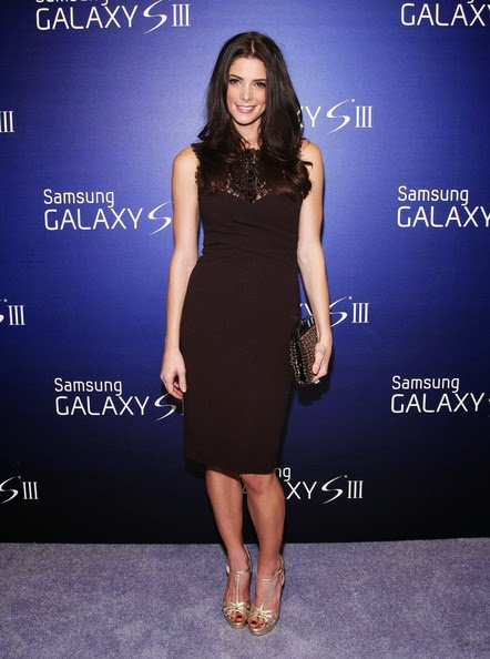 `Twilight` star Ashley Greene in a chocolate knee-length dress from Emilio Pucci, with a crossover bodice and a gemstone embroidered lace neckline at Skylight Studios to host the Samsung Galaxy III Launch on June 20, 2012 in New York City.