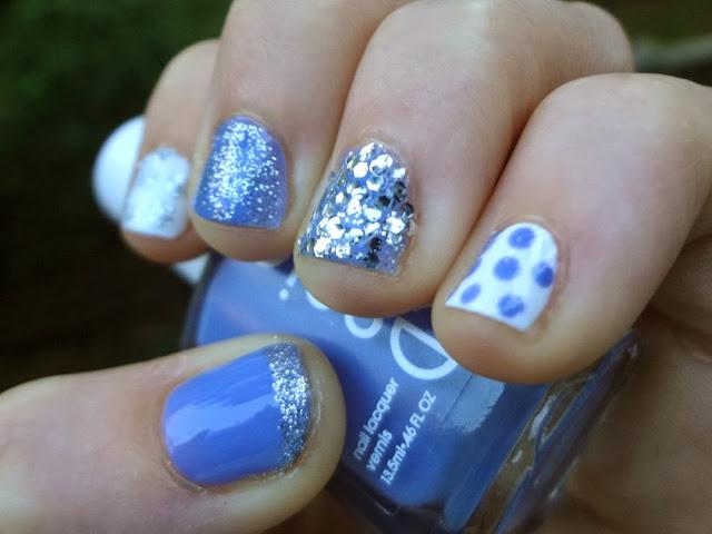 Blue Essie polish with silver glitter, white polish with polka dots