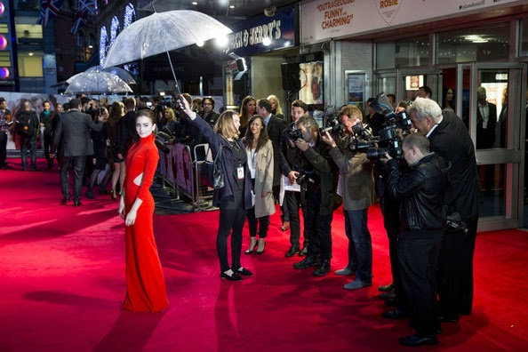 Notice anything different about Lily Collins? No, She's still got it, but the asymmetrical garment number, which was beautified embellishments with her. The actress was spotted wearing a beauty red long dress as she headed the Love Rosie movie premiere at London on Monday, October 6, 2014.