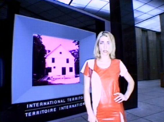Sonic Youth Kim Gordon in a beautiful 90's shiny orange dress. Still / screenshot from Little Trouble Girl (1995)