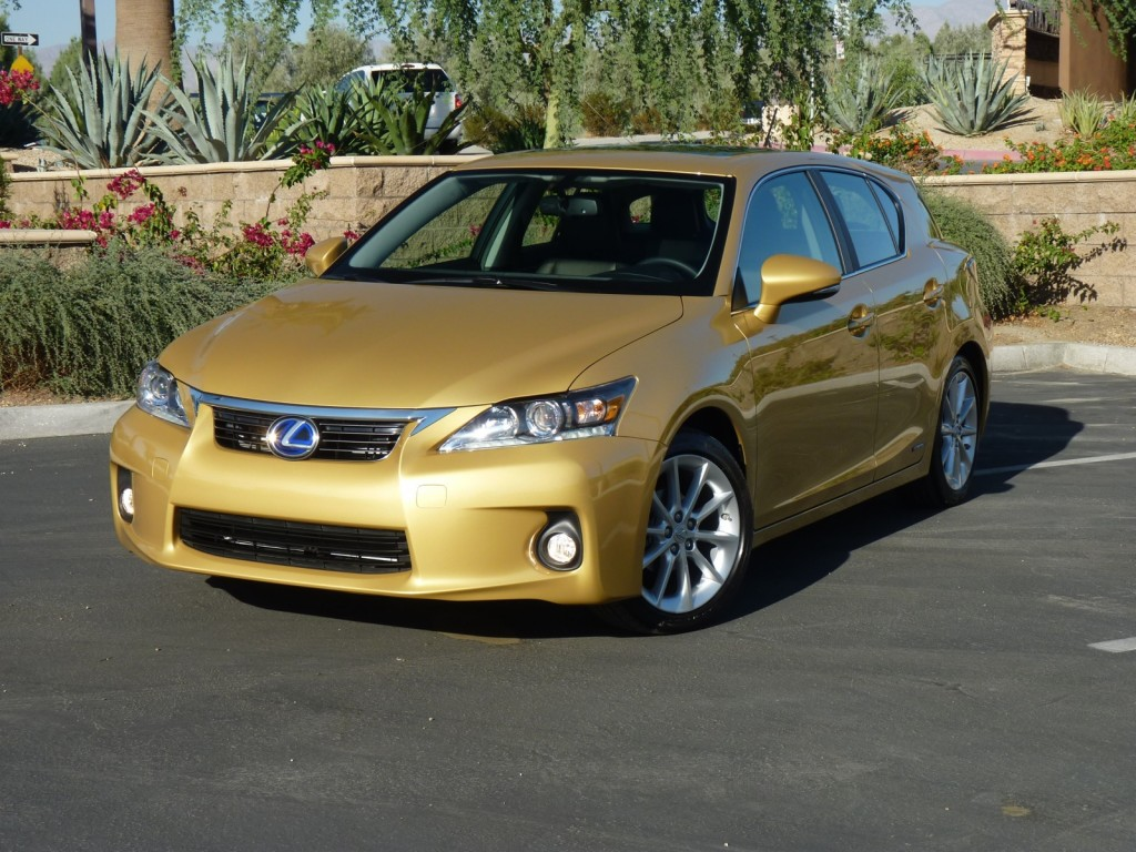 Front 3/4 View Of Gold 2011 Lexus CT 200h Hybrid Parked In Resort Setting