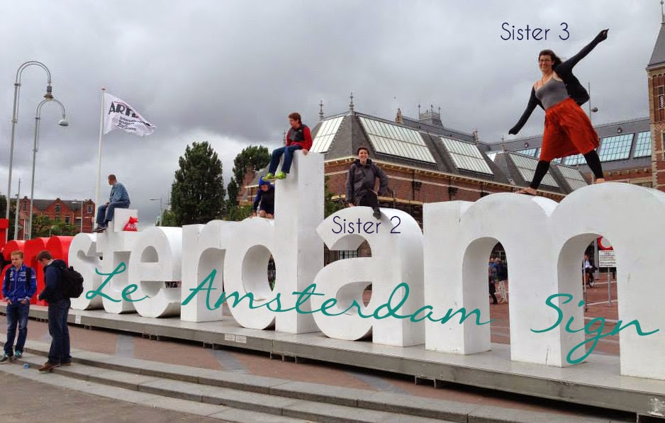 Jenn's sisters standing on the Amsterdam sign | Business, Life & Design