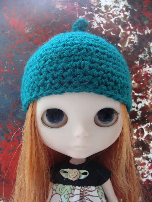 Amika wears cucumber crochet hat