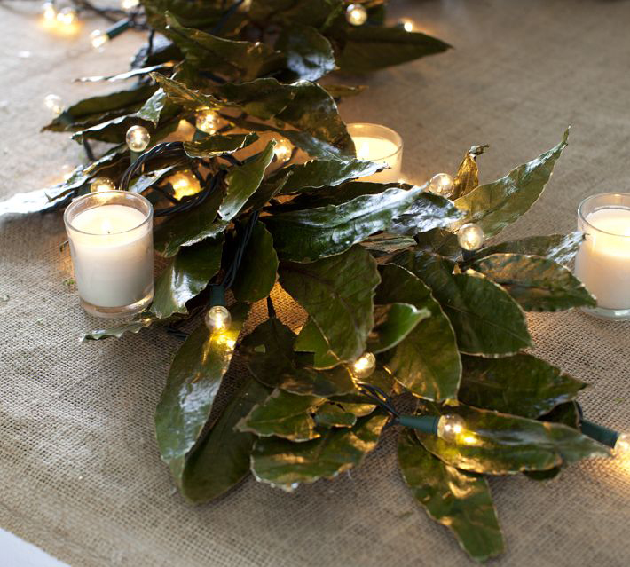 ... candles, gilded bay leaf garland on burlap all from PotteryBarn