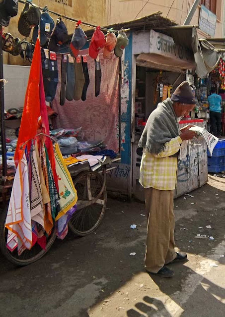 old vendor reading newspaper