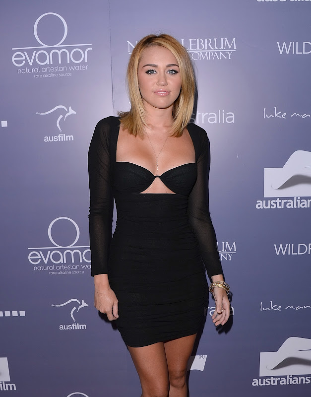 Miley Cyrus sexy in a revealing black outfit