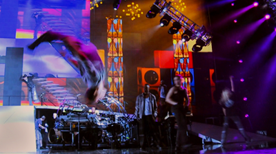 Michael Jackson's – This is it – dancers on stage, air-flip.