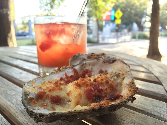 A baked Brie and Bacon oyster and Old Fashioned at Jolie Pearl Oyster Bar in downtown Baton Rouge, LA.