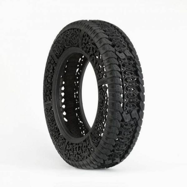 wim-delvoyes-incredible-rubber-carvings-turn-tires-into-art 3