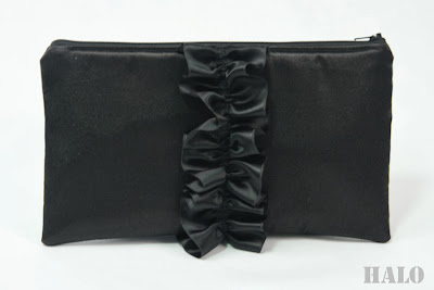 Black ruffled clutch