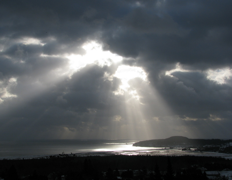 Sunlight Beaming through Moving Clouds