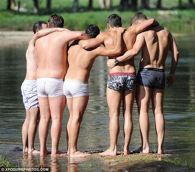 Huddle time: After the swim, Mark and his mates enjoyed a hug as they ...
