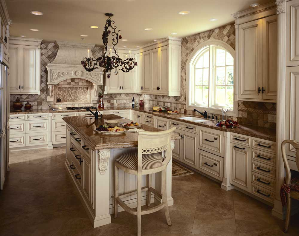 rustic white cabinets with light brown granite dark brown hardware and travertine flooring bring this traditional kitchen into the 20th century