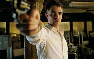 Robert Pattinson as billionaire asset manager Eric Packer, firing his revolves, Cosmopolis (2012), Directed by David Cronenberg