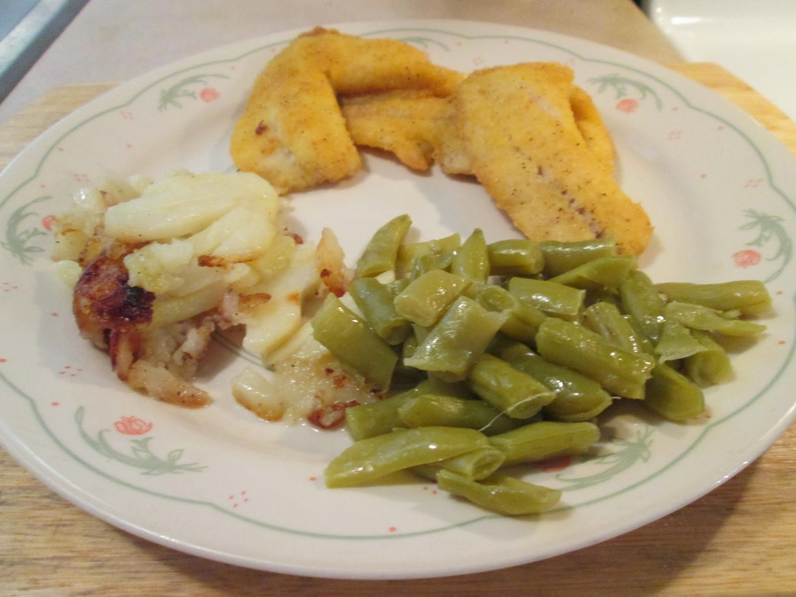fried okeechobee crappie w/ canned green beans, fried potatoes, and...