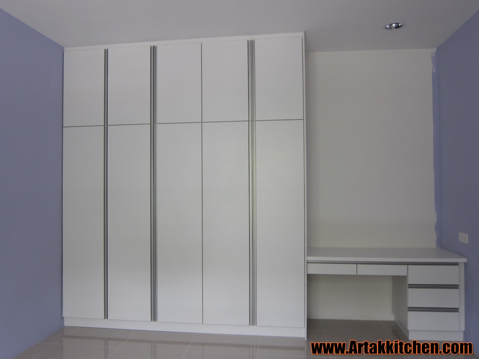 Swing door wardrobe with study table