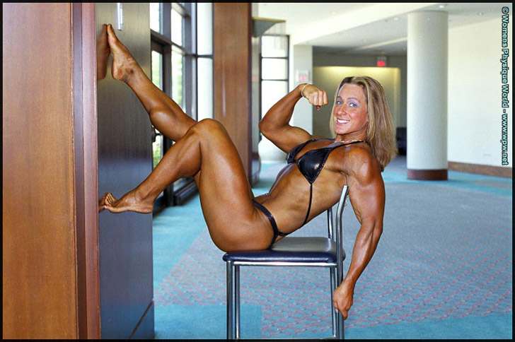 Amanda Dunbar Modeling Her Muscular Legs And Flexing A Bicep