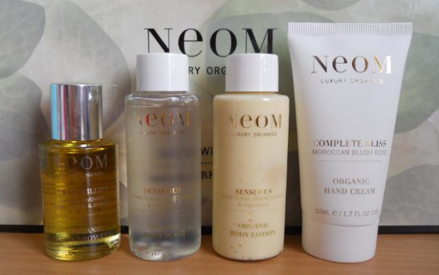 Neom scent with love bodycare gift set. Neom tranquillity bath and shower oil, Neom sensuous body wash, Neom sensuous body lotion, Neom complete bliss organic hand cream