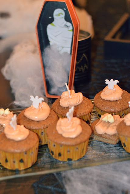 Pumpkin Spice Cupcakes on a tray with decor