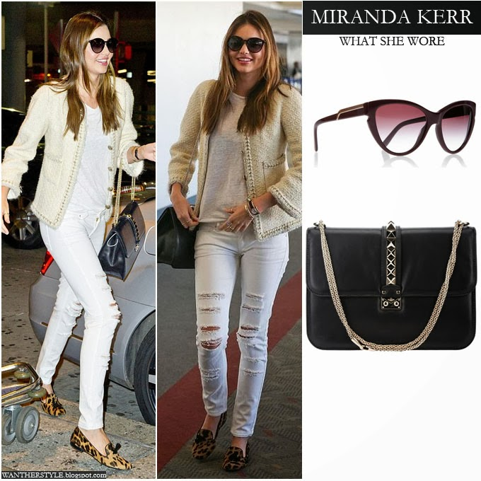 Miranda Kerr in white knit jacket, white distressed jeans, leopard print loafers and black studded Valentino bag Want Her Style