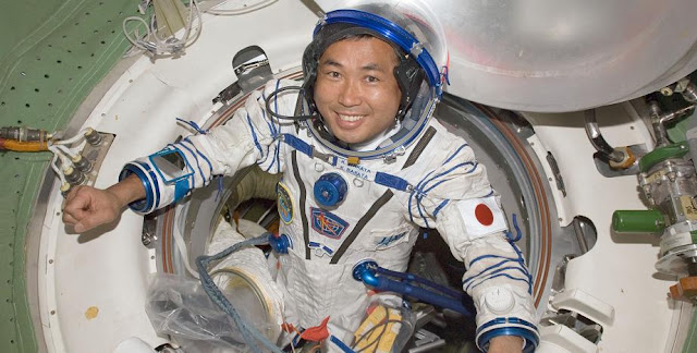 Japan Aerospace Exploration Agency (JAXA) astronaut Koichi Wakata, Expedition 18 flight engineer, attired in his Russian Sokol launch and entry suit, is pictured near a hatch on the International Space Station while Space Shuttle Discovery (STS-119) remains docked with the station. 18 March 2009. Credit: NASA