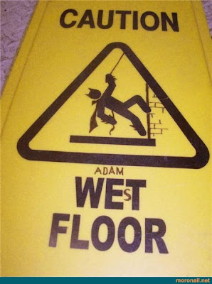 adam west floor sign wet floor