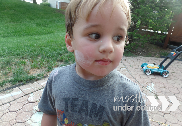 child with chalk paint on his face