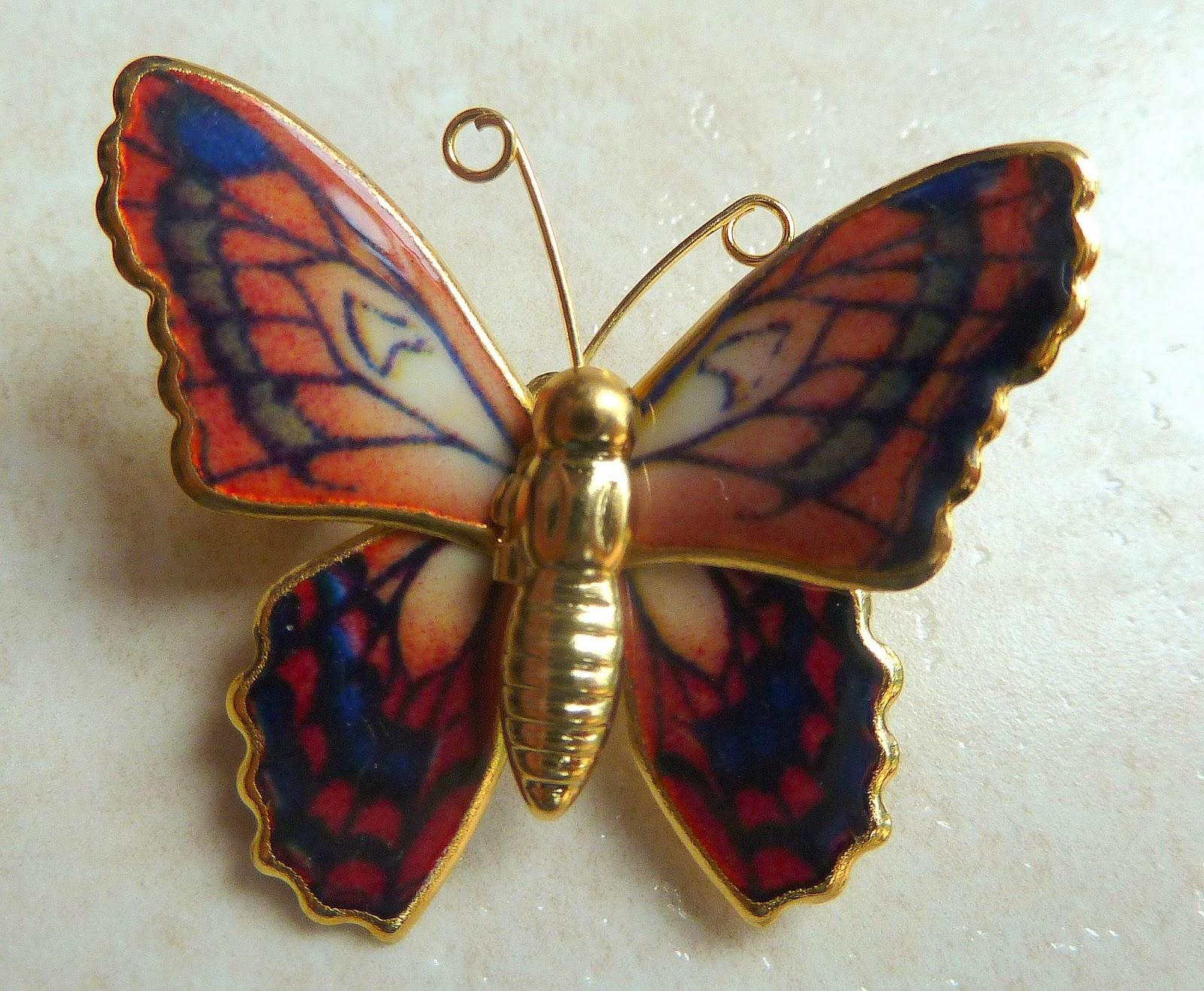 http://www.kcavintagegems.uk/vintage-multicoloured-butterfly-brooch-134-p.asp