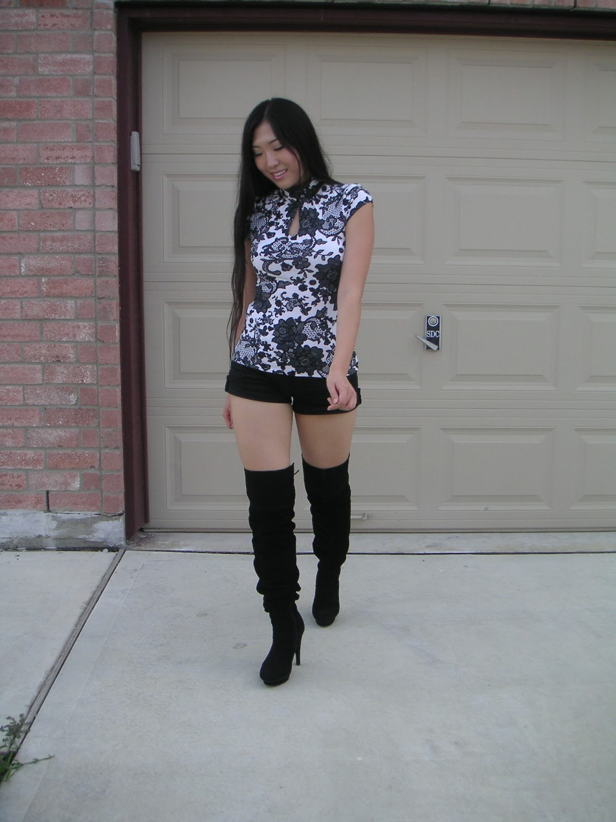 hautess shorts thigh high boots