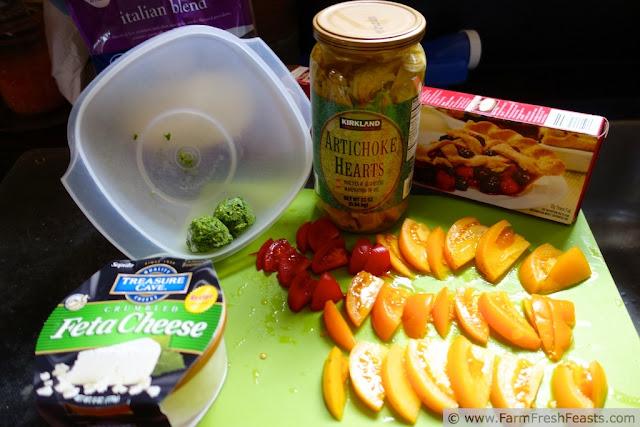 http://www.farmfreshfeasts.com/2013/08/mediterranean-tomato-tart-artichokes.html