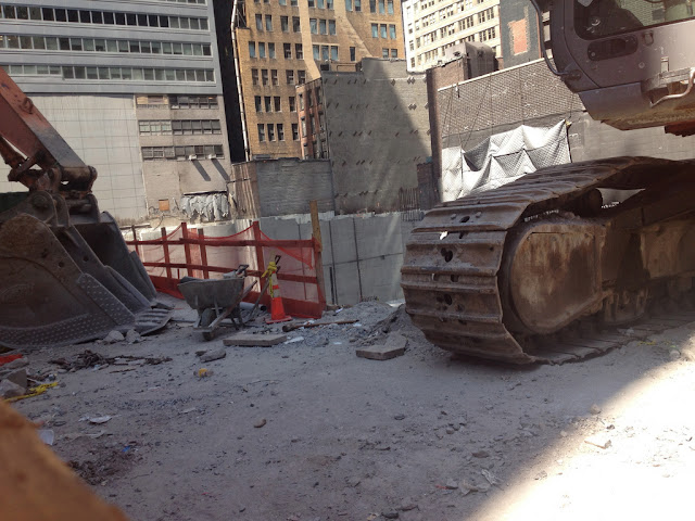 Photo of excavator machine on the site