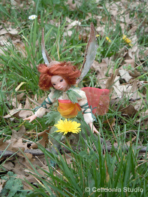 fairy with yellow wild flower