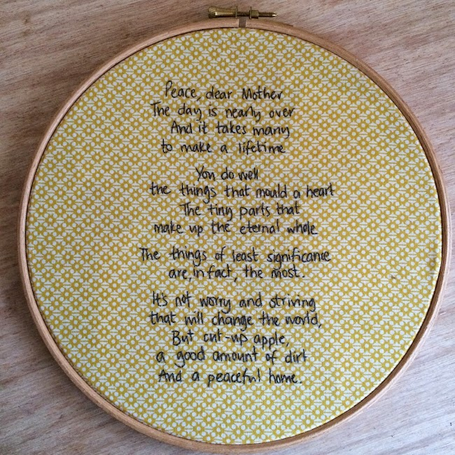 embroidered hand written poem on fabric in embroidery hoop