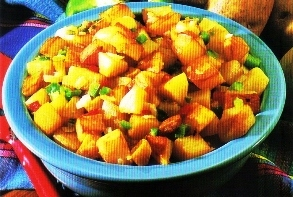 Picture of Irish Potatoes O'brien Style on a blue serving bowl.