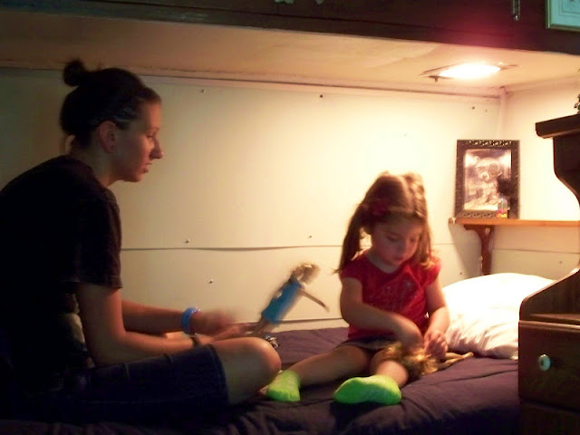 Playing Barbies on the camp bunk