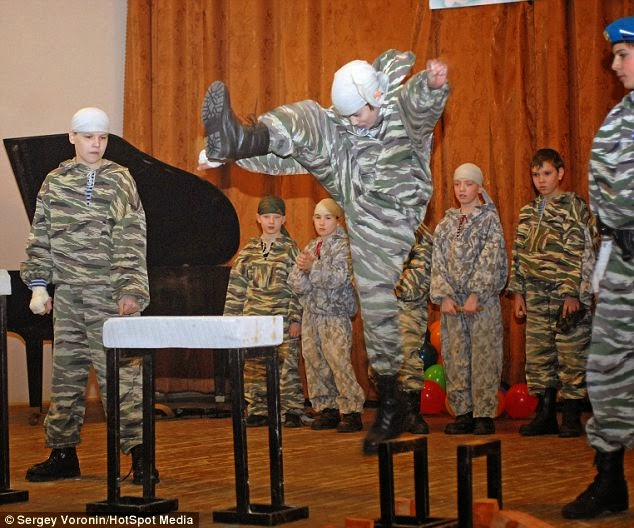 In Russia, Boys Learn To Use Military Equipment – In America, Boys Learn To Play Video Games And Ogle Women
