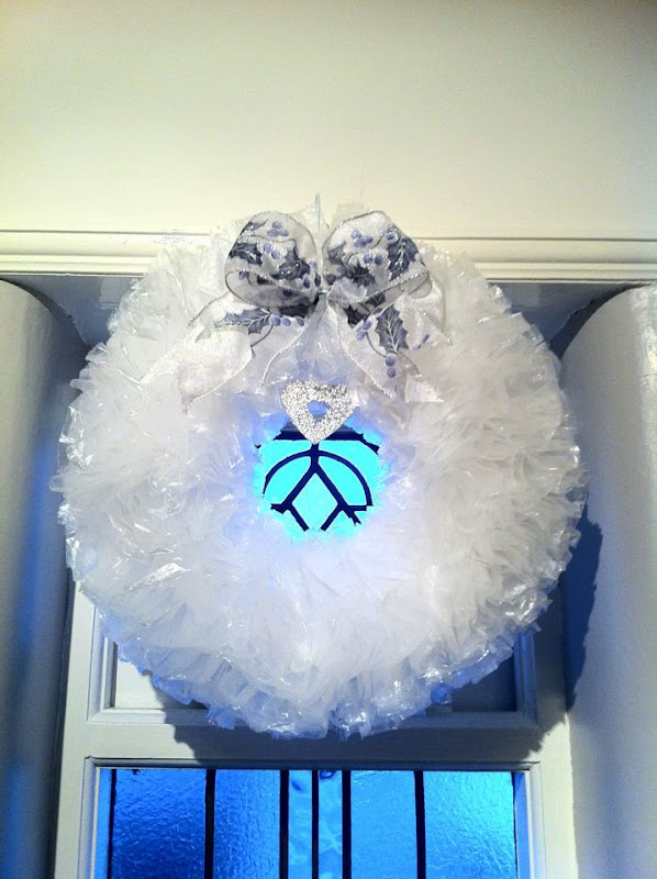 xmas wreath made with Sandwich Bags and a Wire Coat Hanger