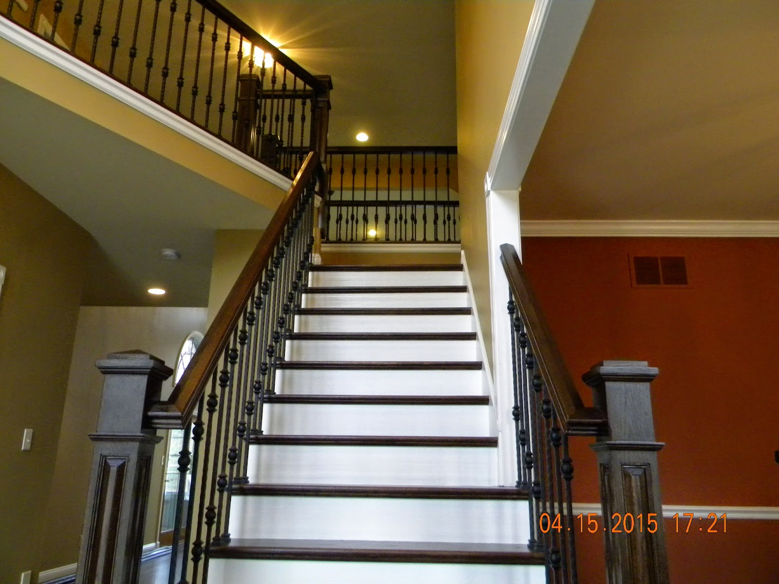 Dark Stained Treads, Rails, And Box Newels With White Risers And Satin  Black Balusters