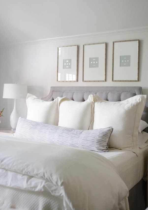 Coastal style chic in grey hamptons style Master bedroom art above bed