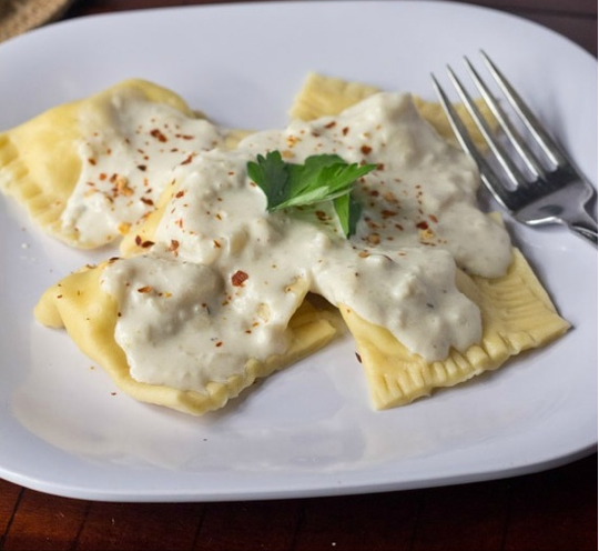 ... Art: Chicken and Artichoke Ravioli with Roasted Garlic Cream Sauce