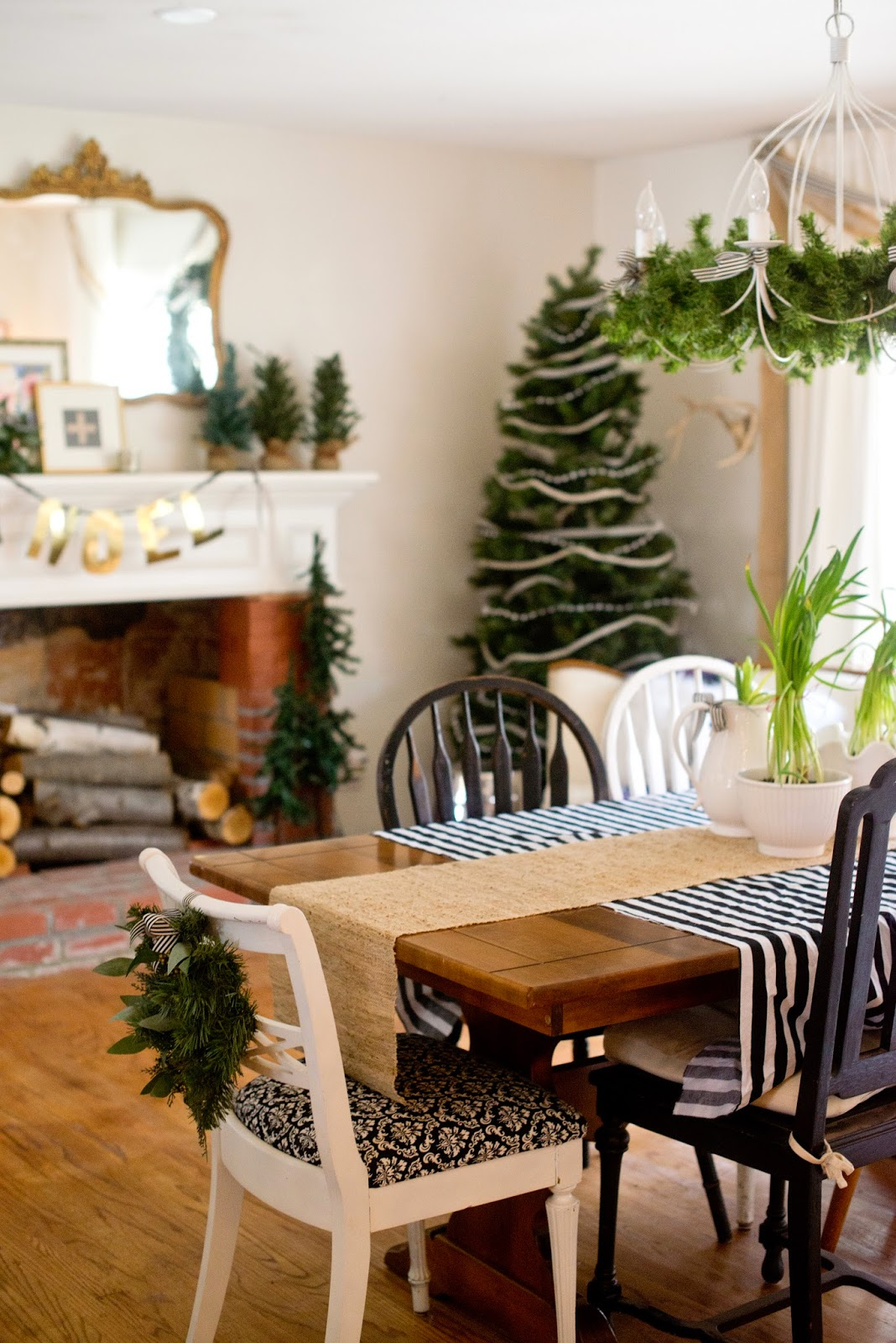domestic fashionista rustic and natural christmas dining room the trimmings on the tress and any type of theme i go with usually consists of ribbon this year i used black and white striped ribbon and fabric to pull