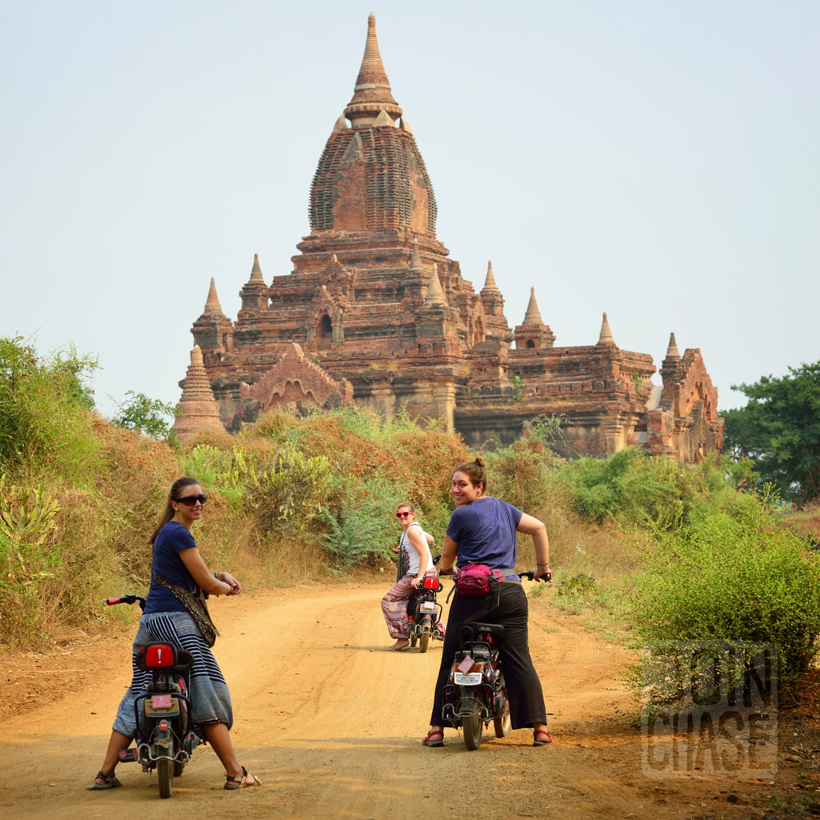 Riding electric scooters around ancient temples of Old Bagan, Myanmar.