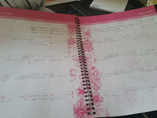 Pink agenda with month long to-do list for daily tasks.
